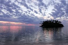 Taakoka islet at dusk Muri lagoon Rarotonga Cook Islands royalty free stock image