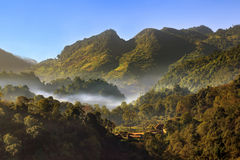 Landscape  view from top of mountain on misty morning. Royalty Free Stock Image