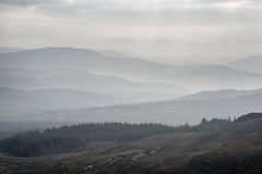 Landscape view from top of mountain on misty morning across coun Royalty Free Stock Photos