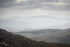 Landscape view from top of mountain on misty morning across coun Royalty Free Stock Images