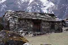 Landscape view of traditional rural stone house in Nepal. `s high mountains. Sagarmatha Everest National Park, Nepal royalty free stock photo