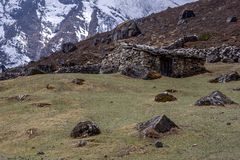 Landscape view of traditional rural stone house in Nepal`s high. Mountains. Sagarmatha Everest National Park, Nepal royalty free stock photo