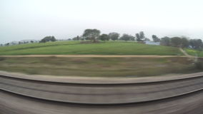 Landscape view during a train ride through India. stock footage