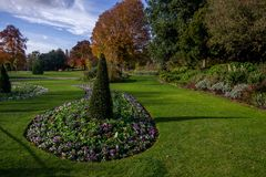 Landscape view of trees, flowers and meadow in the Hyde park. London, United Kingdom royalty free stock images