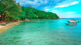 Landscape view of troical beach in the island. Beautiful view of tropical beach and sea with sunny sky in the summer at the small island royalty free stock photography
