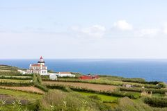 Landscape with a view of the villa from the ocean, Portugal, Azores stock photo