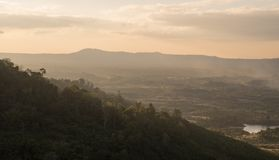 A landscape view of village in the middle of green mountains dur royalty free stock photography