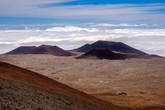 Landscape view of volcanic craters above clouds at Mauna Kea, Hawaii Royalty Free Stock Photos