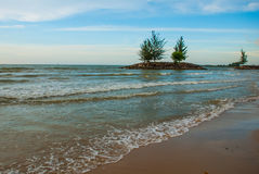 Landscape view of the water in the evening pipe with the fire on the horizon, city Bintulu, Borneo, Sarawak, Malaysia. Pantai Tema Stock Image