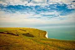 Landscape view of the White Cliffs at Dover. View of the English channel as seen from above the White cliffs of Dover. The Lighthouse is called South Foreland Stock Photos