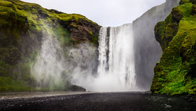 Landscape view of wild Skogafoss waterfall in Iceland Stock Photos