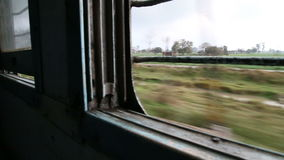 Landscape view through the window during a train ride in Amritsar. stock video footage