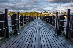 Landscape view of wooden platform on the river Thames. stock images
