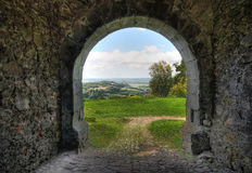 Landscape viewed through a stone gate (HDR) Stock Images