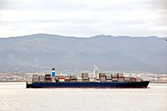 Panoramic views of the port and the city of Gibraltar during day and night. Kind of cargo and merchant vessels anchored. stock photos