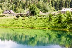 Landscape of village and blue lake sarva. Russia Stock Photos