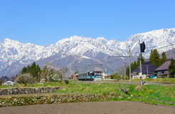 Landscape of the village of Hakuba. JR Oito line and Shirouma mountains in the village of Hakuba, Nagano, Japan Royalty Free Stock Photo