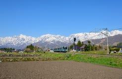 Landscape of the village of Hakuba. JR Oito line and Shirouma mountains in the village of Hakuba, Nagano, Japan Stock Image