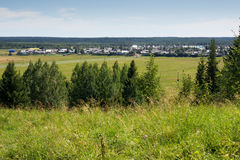 Landscape with village from high point. Rural landscape with village and natural frame of trees Royalty Free Stock Image