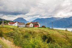 Landscape in Norway. Landscape with village houses, mountains and fjord in Norway Royalty Free Stock Photo