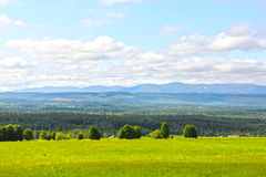 Landscape and village. Landscape with mountains and scandinavian village at summer Royalty Free Stock Photography