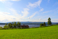 Landscape and village. Landscape with mountains and scandinavian village at summer Royalty Free Stock Images