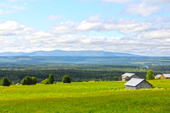 Landscape and village. Landscape with mountains and scandinavian village at summer Stock Photography