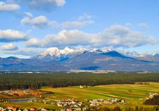 Landscape of villages, forest and mountains. With blue sky clouds Stock Photos
