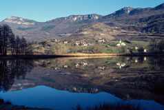 Landscape of vineyards, village and lake in France Stock Photos