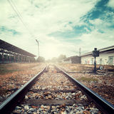 Landscape vintage of railroad tracks at train station Stock Photos