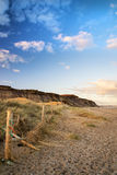 Landscape vivd sunset over beach and cliffs Stock Images