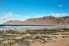 Landscape with volcanic hills and atlantic ocean in Lanzarote Stock Image