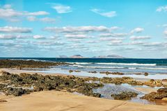 Landscape with volcanic hills and atlantic ocean in Lanzarote Royalty Free Stock Images