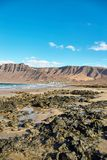 Landscape with volcanic hills and atlantic ocean in Lanzarote Royalty Free Stock Photography