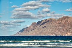 Landscape with volcanic hills and atlantic ocean in Lanzarote Stock Photography