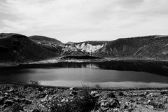 Landscape. A volcanic lake and hills Stock Images