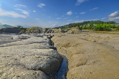Landscape with volcanic soil and natural drain channel Stock Photos