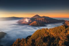 Landscape of Volcano Erupting at Sunrise Scene., Natural Scenery of Crater Mount at Bromo Tengger Semeru National Park, Indonesia. Travel Destination and royalty free stock photography