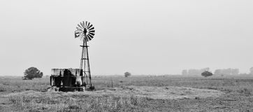 Water pump windmill. Landscape with water pump windmill on cattle farm westerncape south africa royalty free stock image