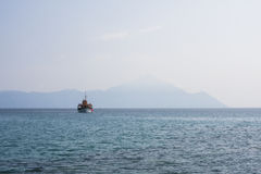 Landscape with water, ship and rocks - Aegean sea, Greece Stock Photo