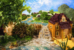 Landscape with watermill made from food Stock Image