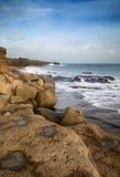Landscape of waves crashing onto rocks during beautiful Winter's Stock Photography