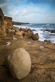 Landscape of waves crashing onto rocks during beautiful Winter's Stock Images