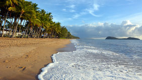 Landscape of waves rolling onto the shore of Palm Cove Queenslan Stock Photo