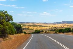 Landscape of Western Australia besides the road with hills and farm. Land stock photography