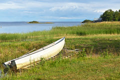 Landscape with white boat on shore Stock Photo