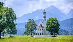 Landscape with white church and Alps mountains, Germany Royalty Free Stock Photo
