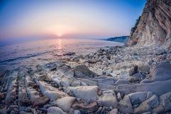 Landscape white rocky layered seashore at sunset, fisheye distortion. Landscape white steep rocky layered seashore at sunset, fish eye distortion royalty free stock photo