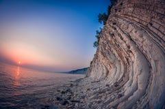Landscape white rocky layered seashore at sunset, fisheye distortion. Landscape white steep rocky layered seashore at sunset, fish eye distortion stock images