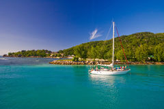Landscape with white yacht. White yacht near tropical islands. Can be used by travel or estate agency Stock Photography